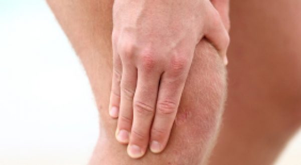 Knee Pain. Sports running knee injury in male runner.